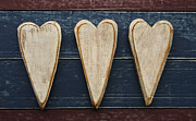 Three Wooden Hearts Print by Carol Leigh