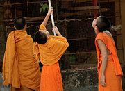 Gathering Photos - Three Young Monks Laos by Bob Christopher