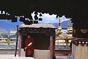 Tibetan Buddhism Metal Prints - Tibetan Monk with Scroll on Jokhang Roof Metal Print by Anna Lisa Yoder