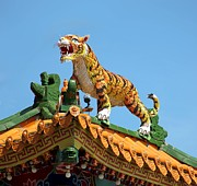 Chinese Tiger Prints - Tiger Sculpture Decorates Chinese Temple Roof Print by Yali Shi