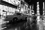 Manhattan Framed Prints - Times Square NYC taxi cab Framed Print by John Farnan
