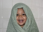 Wrapped In A Towel Posters - Toddler in a Towel Poster by Sheldon Barreto
