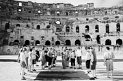 Ancient Rome Art - Tour Guide Explains To Group Of British Tourists About Gladiator Pits On The Floor Of The Arena Of The Old Roman Colloseum At El Jem Tunisia by Joe Fox