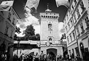 Polish City Framed Prints - tourists and visitors at the Florianska Gate old city entrance to krakow Framed Print by Joe Fox