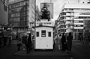 West Berlin Framed Prints - tourists at checkpoint charlie ersatz cabin reconstruction in the middle of Friedrichstrasse Berlin Framed Print by Joe Fox