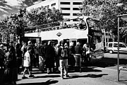 Catalunya Prints - Tourists Boarding Busy Open Top City Tours Barcelona Catalonia Spain Print by Joe Fox