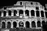 Rebuilt Prints - Tourists exit the rear entrance to the colosseum Rome Lazio Italy Print by Joe Fox