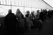 Manhatten Prints - Tourists  Look At The View From Observation Deck Empire State Building Print by Joe Fox