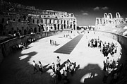 Ancient Rome Art - Tourists On The Arena Floor Of The Old Roman Colloseum At El Jem Tunisia by Joe Fox