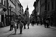 Polish City Prints - Tourists On The Ulica Florianska Street Leading Down From City Gates To Old Town City Centre Krakow Print by Joe Fox