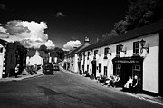 Village Life Prints - Tourists Outside Fitzgeralds Pub And Main Road In The Village Of Avoca From The Tv Series Ballykissangel Print by Joe Fox