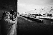 Winter Photos Prints - Tourists Taking Photos Of Havoysund Hurtigruten Pier Finnmark Norway Europe Print by Joe Fox