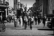 Polish City Framed Prints - tourists walking along Grodzka street towards camera and towards main town square in Krakow Framed Print by Joe Fox