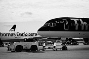 Charters Prints - Tow Vehicle And Aircraft Waiting On Stands At Reus Airport Catalonia Spain Print by Joe Fox