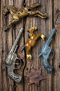 Badge Prints - Toy guns and horses Print by Garry Gay