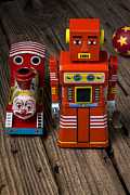 Robotic Framed Prints - Toy robot and train Framed Print by Garry Gay