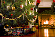 Christmas Eve Photo Posters - Toy Train Under the Christmas Tree Poster by Diane Diederich