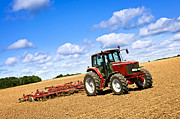 Industrial Metal Prints - Tractor in plowed farm field Metal Print by Elena Elisseeva