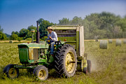 Bailing Hay Photos - Tractor Man by Michael Huddleston
