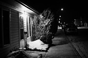 Sask Prints - Traditional House With Porch Light Outside The Door And Snow Cleared Pavements At Night Delisle Sask Print by Joe Fox