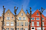 Rooftop Prints - Traditional old Belgium House Facades in Bruges Print by Kiril Stanchev