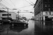 Tram Prints - traffic at the junction of main and broadway on a wet rainy day Vancouver BC Canada Print by Joe Fox