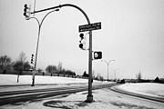 Winter Roads Prints - traffic lights intersection main road during freezing winter weather Saskatoon Saskatchewan Canada Print by Joe Fox