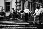 Police Officer Framed Prints - traffic speeds past as Roman Municipal policeman directs pedestrians across the road at a pedestrian crossing in the Via Teatro Marcello Rome Lazio Italy Framed Print by Joe Fox