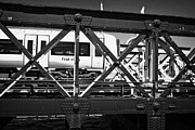 Charing Cross Framed Prints - train crossing metal hungerford rail bridge over the river thames London England UK Framed Print by Joe Fox
