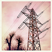 Transmission Photo Framed Prints - Transmission line with bare trees and red sky Framed Print by Matthias Hauser
