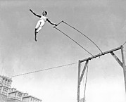 Entertainers Photo Prints - Trapeze Artist On The Swing Print by Underwood Archives