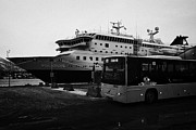 Integrated Prints - troms public bus and hurtigruten mv polarlys at Tromso harbour troms Norway europe Print by Joe Fox
