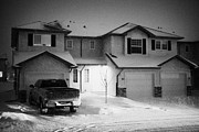 Snow Falling Prints - truck parked outside house with snow falling in residential neighborhood in Saskatoon Saskatchewan C Print by Joe Fox