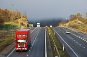 Delivery Truck Posters - Trucks Driving Through A Misty Mountain Pass Poster by Christian Lagereek