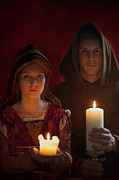 Youthful Prints - Tudor Medieval Young Attractive Couple  Holding  Candles Print by Lee Avison