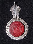 Lion Jewelry - Turkoman silver pendant decorated with carnelian featuring a menorah and the Judean lions.  by Turkoman silversmith master