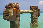 Fishing Pier Prints - Twin Rusted Dock Piers of the Caribbean Print by David Letts