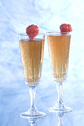 Champagne Glasses Photos - Two glasses of champagne with strawberries by Kris Mercer