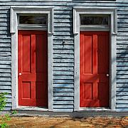 Siding Prints - Two Red Doors Print by Mel Steinhauer