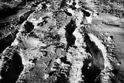 two sets of fresh footprints crossing deep snow in field Forget Saskatchewan Canada Print by Joe Fox
