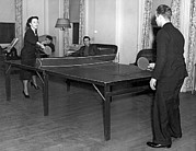 College Students Posters - Two students playing ping-pong in the recreation hall at Columbi Poster by Underwood Archives