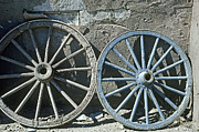 Wagon Wheels Photos - Two  Wagon Wheels in Old Tucson by Robert  Woolley