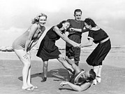 Bathing Photos - Two Women Tussle On The Beach by Underwood Archives