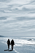 Women Together Metal Prints - Two Women Walking At The Beach In The Winter Metal Print by Jose Elias - Sofia Pereira