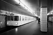 Bahn Prints - u-bahn train pulling in to ubahn station Berlin Germany Print by Joe Fox
