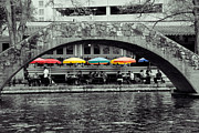 Riverwalk Posters - Umbrellas of Many Colors Poster by John Kain