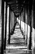 Pillars Photo Framed Prints - Under Huntington Beach Pier Black and White Picture Framed Print by Paul Velgos