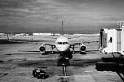 Air Travel Framed Prints - united airlines aircraft pushing back from stand at the San Francisco International Airport Framed Print by Joe Fox