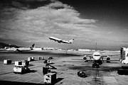 United Airline Framed Prints - united airlines aircraft taking off taxiing and on stand at the San Francisco International Airport  Framed Print by Joe Fox