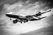 Jet Photo Prints - United Airlines Airplane in Black and White Print by Paul Velgos